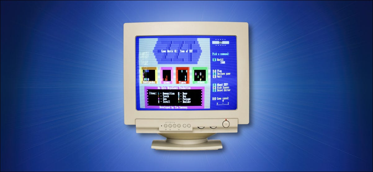 A CRT computer monitor on a blue background.