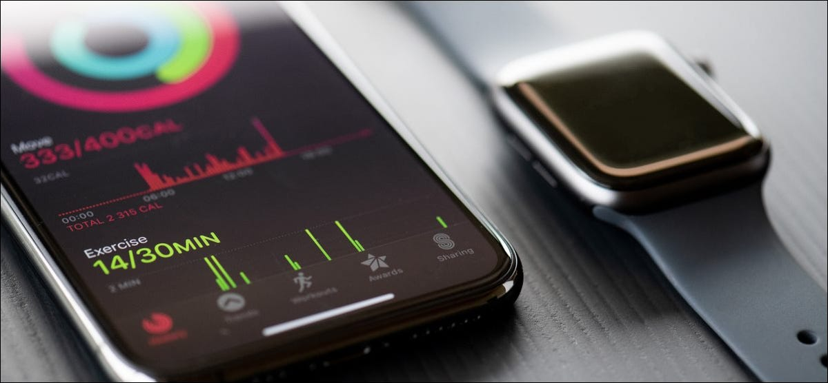 An Apple Watch Series 5 next to an iPhone 11 Pro.