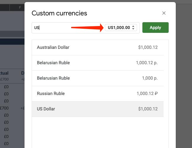 Щелкните раскрывающееся меню формата валюты.