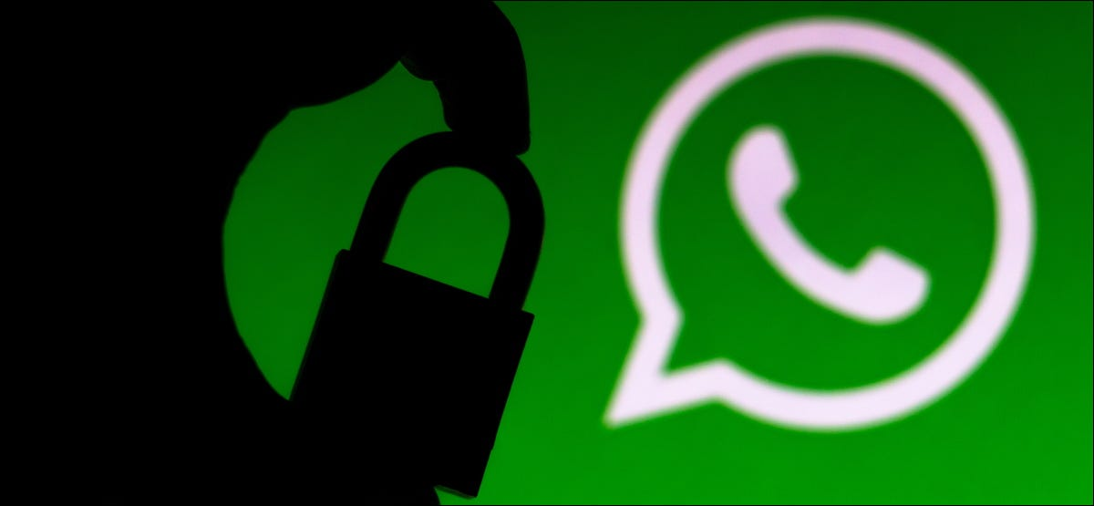 A silhouette of a padlock in front of a WhatsApp logo.