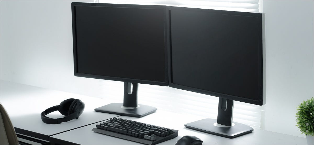 Dual monitors in a workspace.