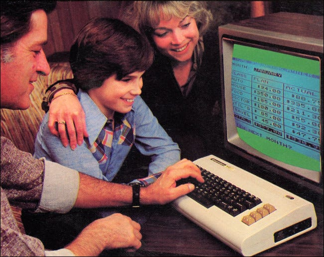 A mom, dad, and son gathered around a Commodore VIC-20.