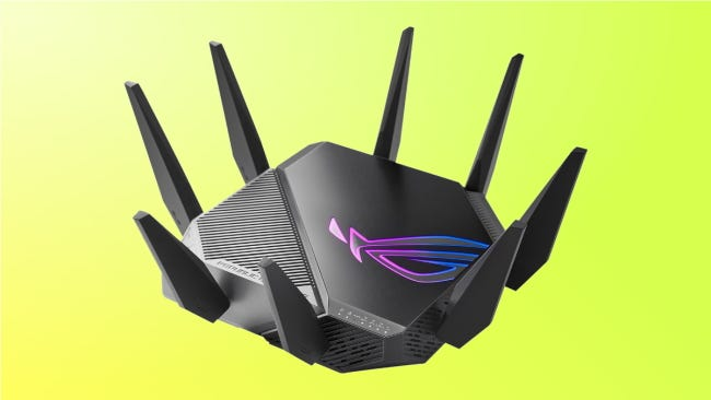 Asus GT AXE11000 on yellow background