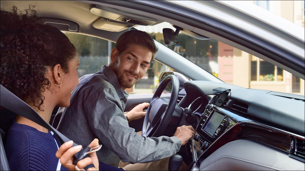 Two people in a vehicle with an Echo Auto.