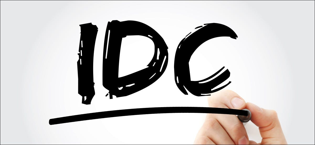 """The letters """"IDC"""" written with a black marker."""