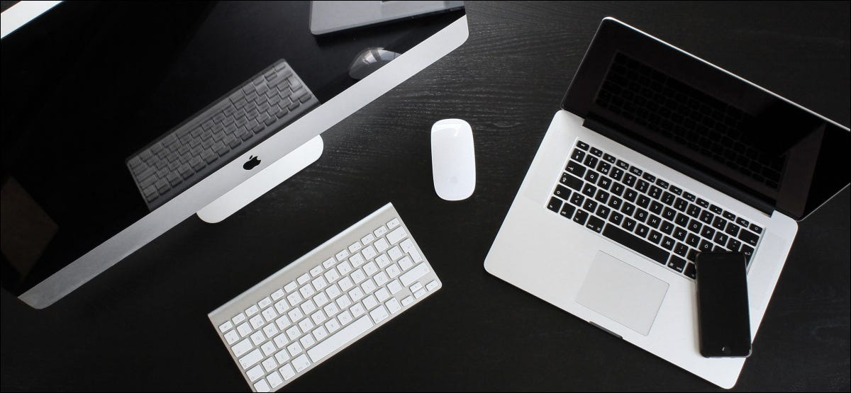 A powered-off iMac, MacBook, and various peripherals.