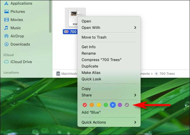 Right-click a file and select a colored tag circle from the menu.
