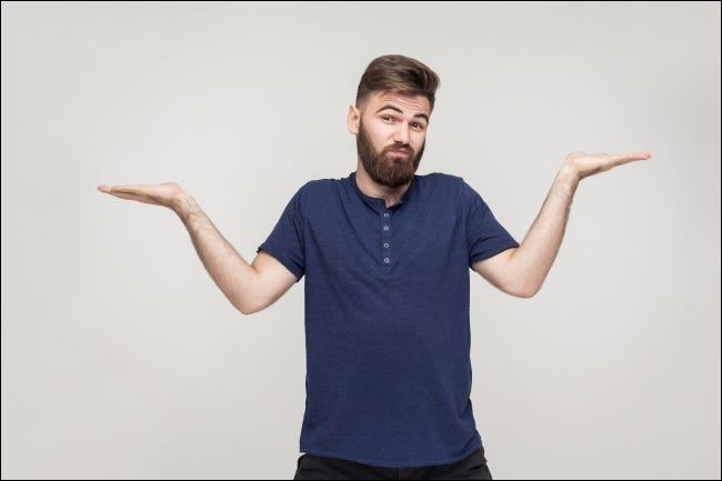 A man giving an exaggerated shrug.
