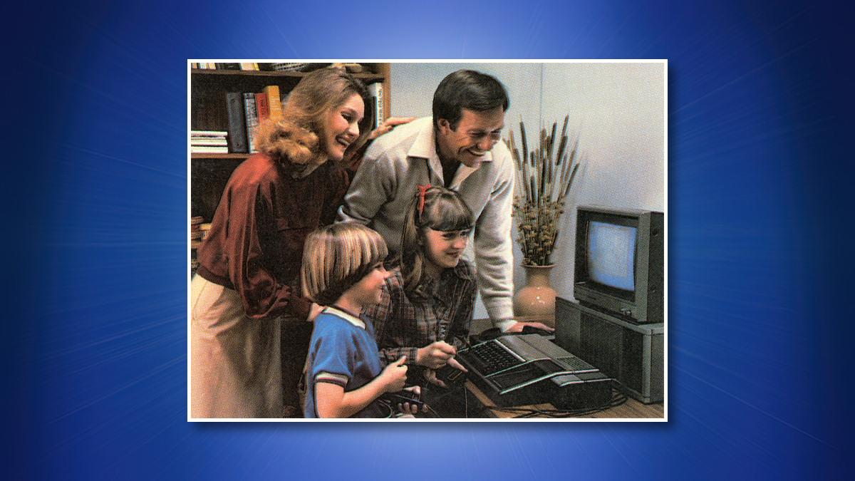 A family playing a TI-99/4A.