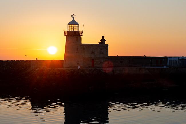 sunrise over a lighthouse