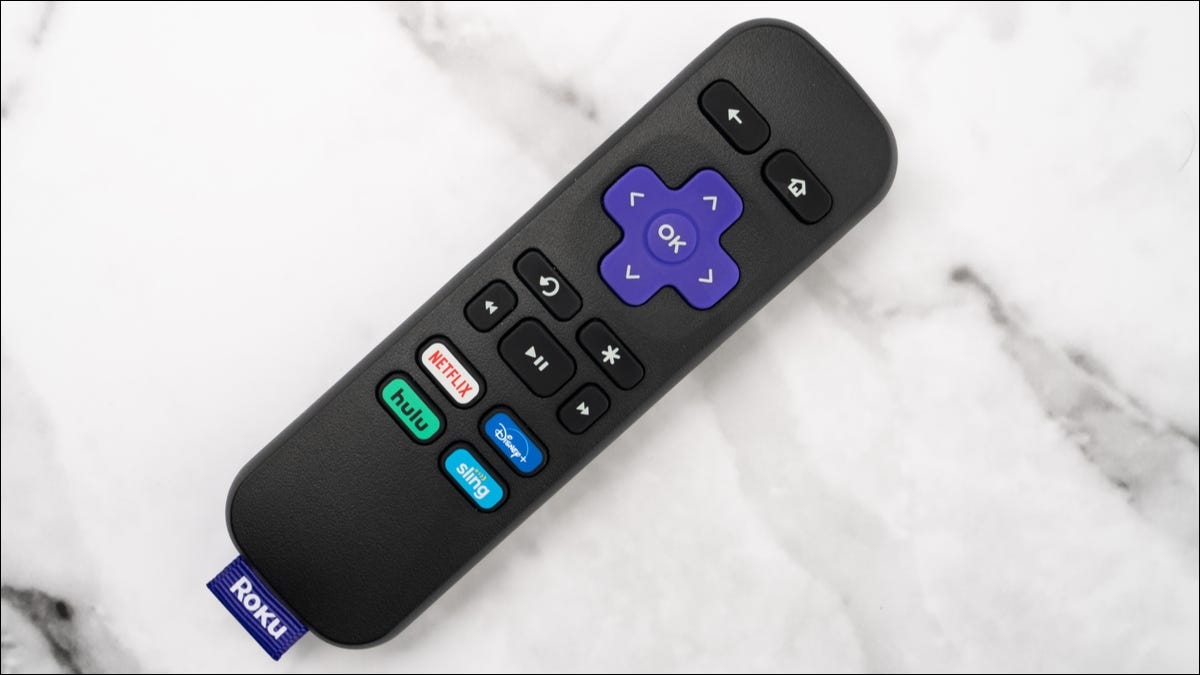 A Roku remote laying on a table