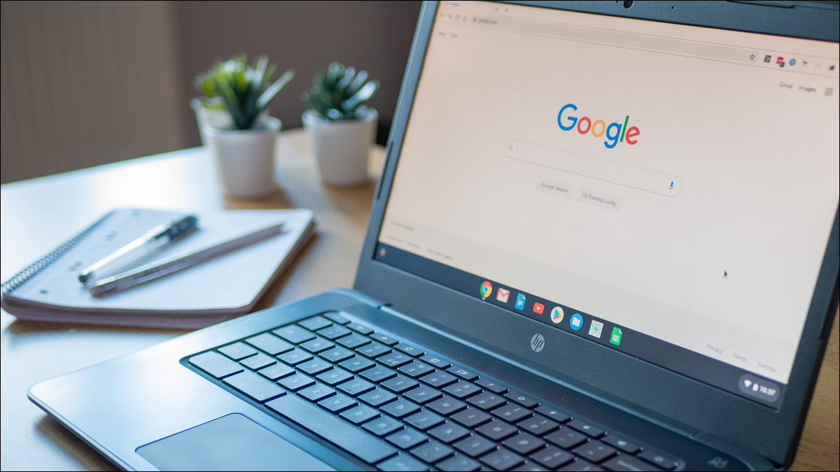 Chromebook sitting on a desk with Google's website on-screen