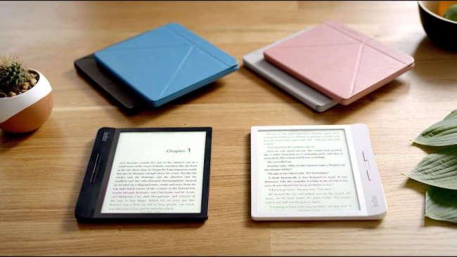 Kobo readers on table next to kobo cases
