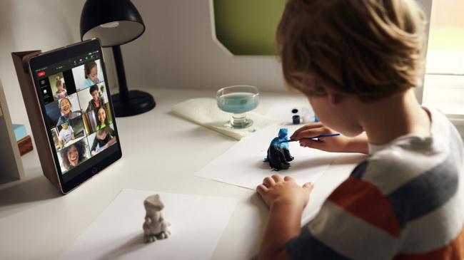 child using iPad in virtual classroom