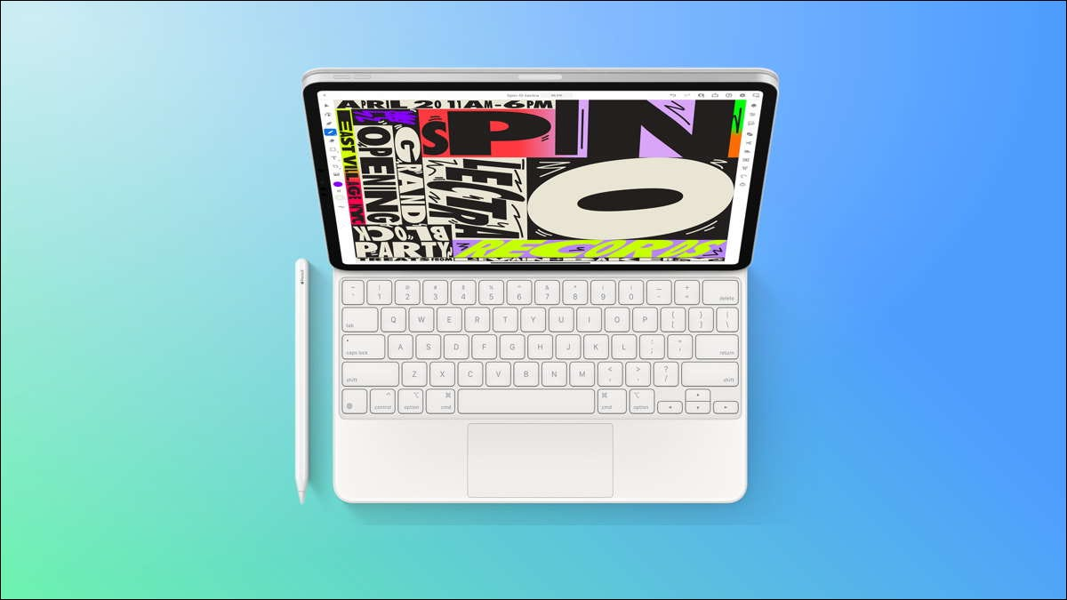 ipad with keyboard and pencil on blue and green background