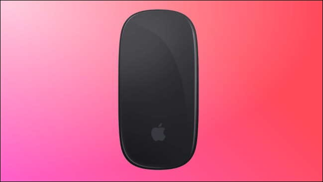 graphite apple magic mouse on red-pink background