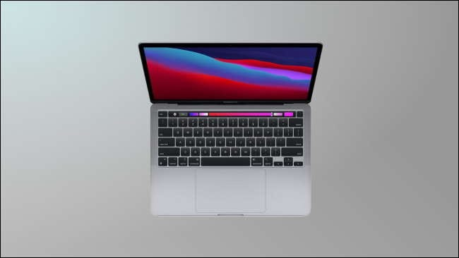 M1 macbook Pro on grey background