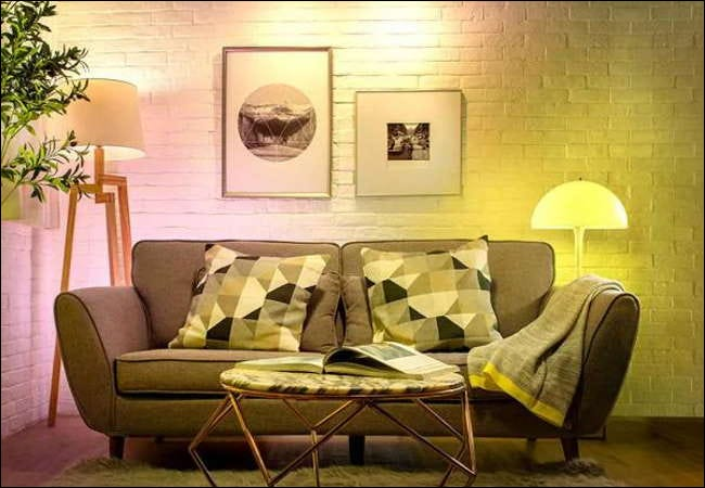 Two Wiz smart light bulbs being used in living room lamps