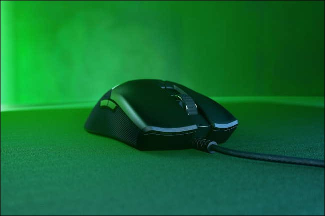 Razer Viper mouse on table with green RGB lighting