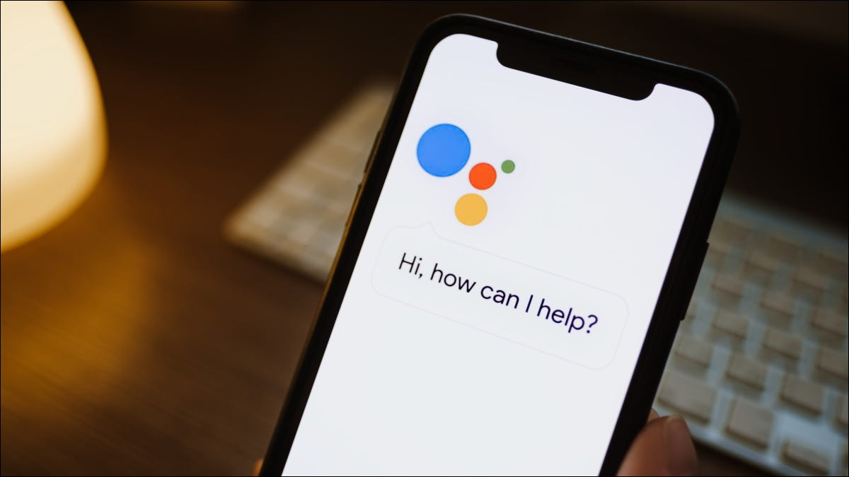 The Google Assistant app asking for voice input on an iPhone.
