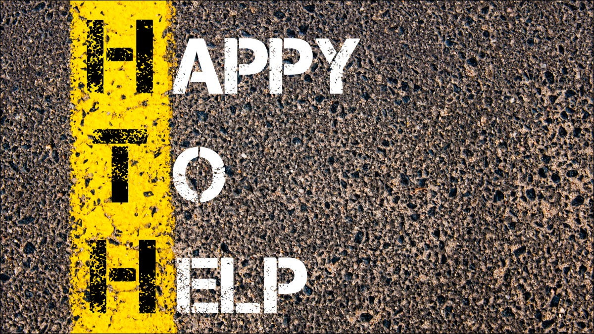 """""""Happy to Help"""" painted on an asphalt road"""