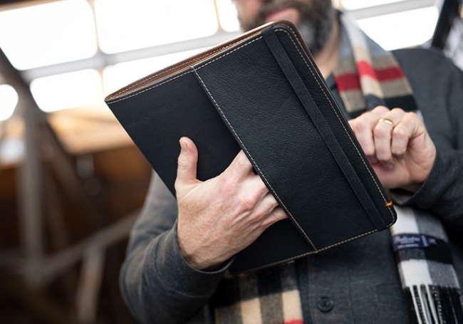 man using iPad Pro in oxford case