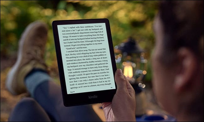 Person reading Paperwhite Signature in the shade