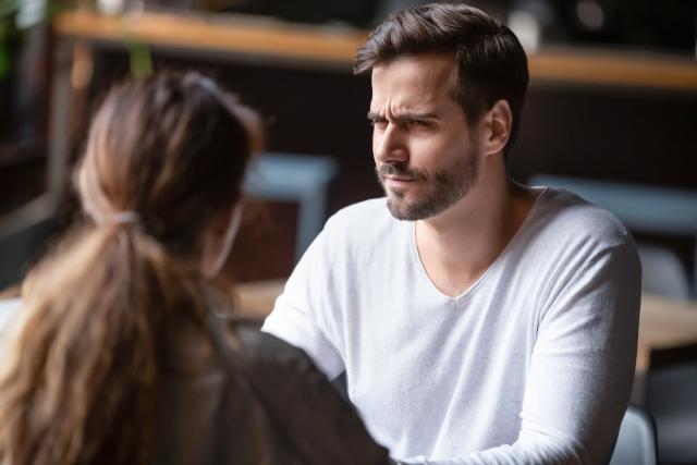 Man looking at woman with suspicion
