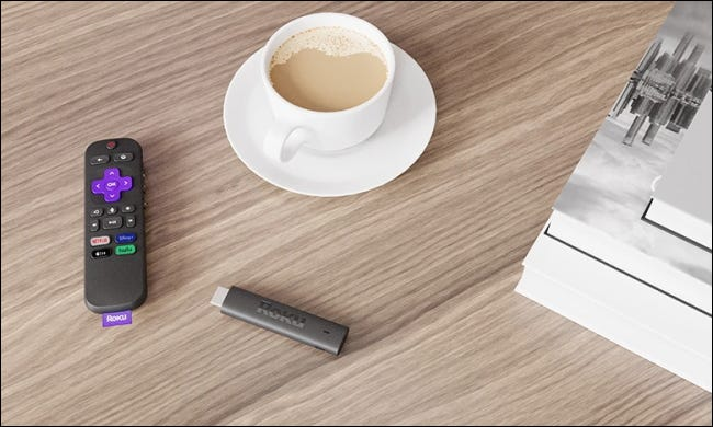 Roku streaming stick 4k on table with coffee