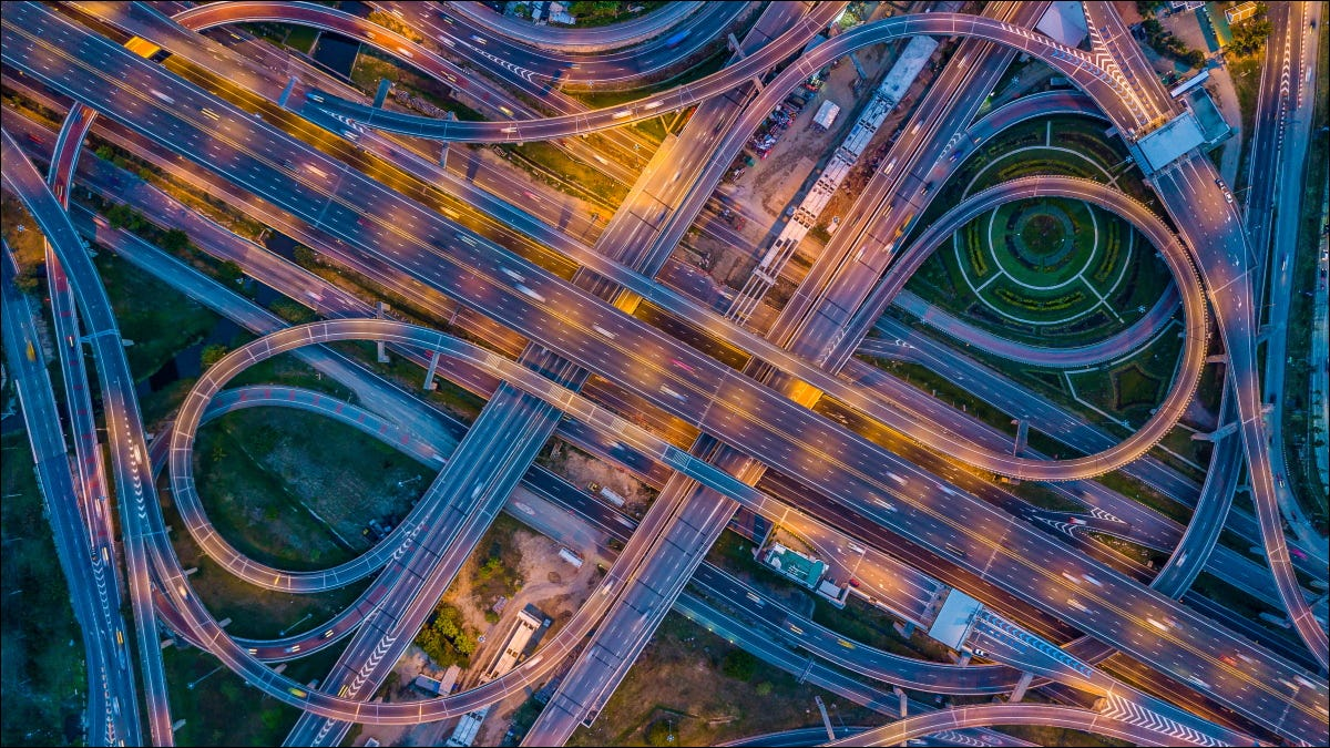 An aerial view of traffic on an expressway in a city.