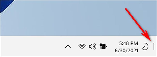 "The Windows 11 ""Show Desktop"" line in the taskbar."