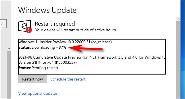 You'll see the Windows 11 Preview download progress in Windows Update.