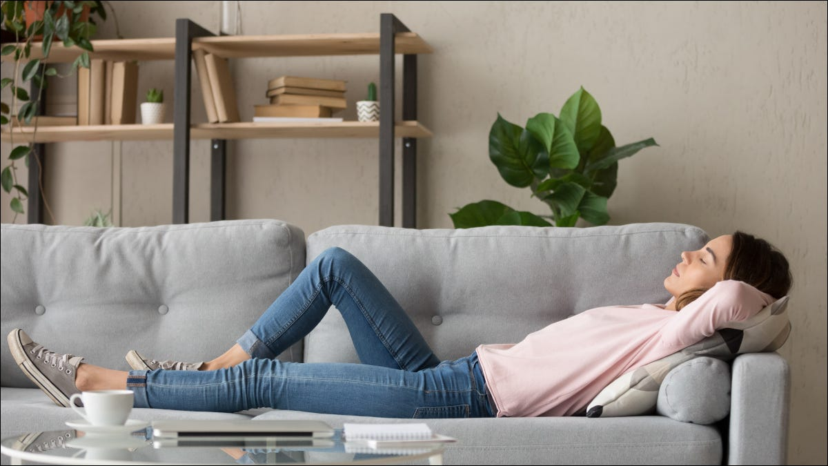 Young woman napping on a gray couch