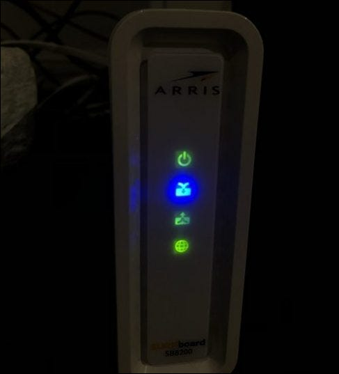 A network modem with four lights lit up