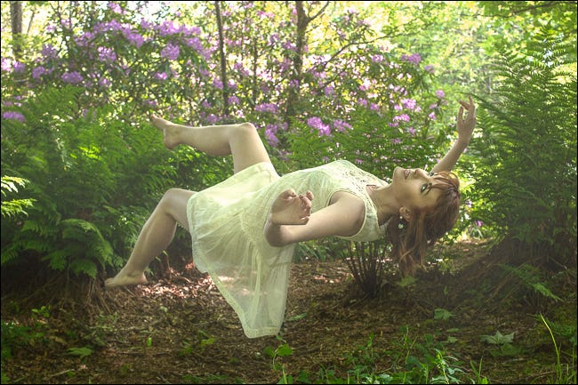 """A woman """"levitating"""" thanks to composite photography."""