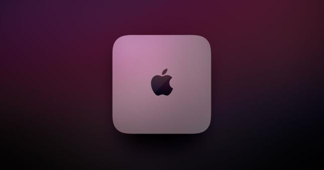 Mac mini near a dark red light