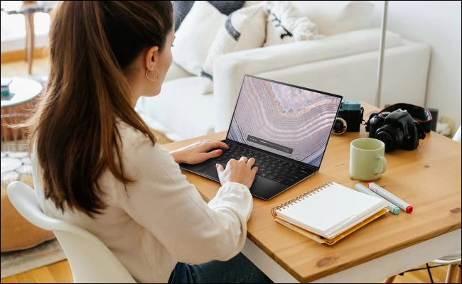 woman using dell xps 13 at home