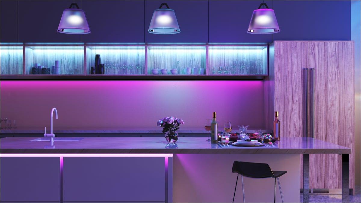 kitchen area with light blue and pink lighting