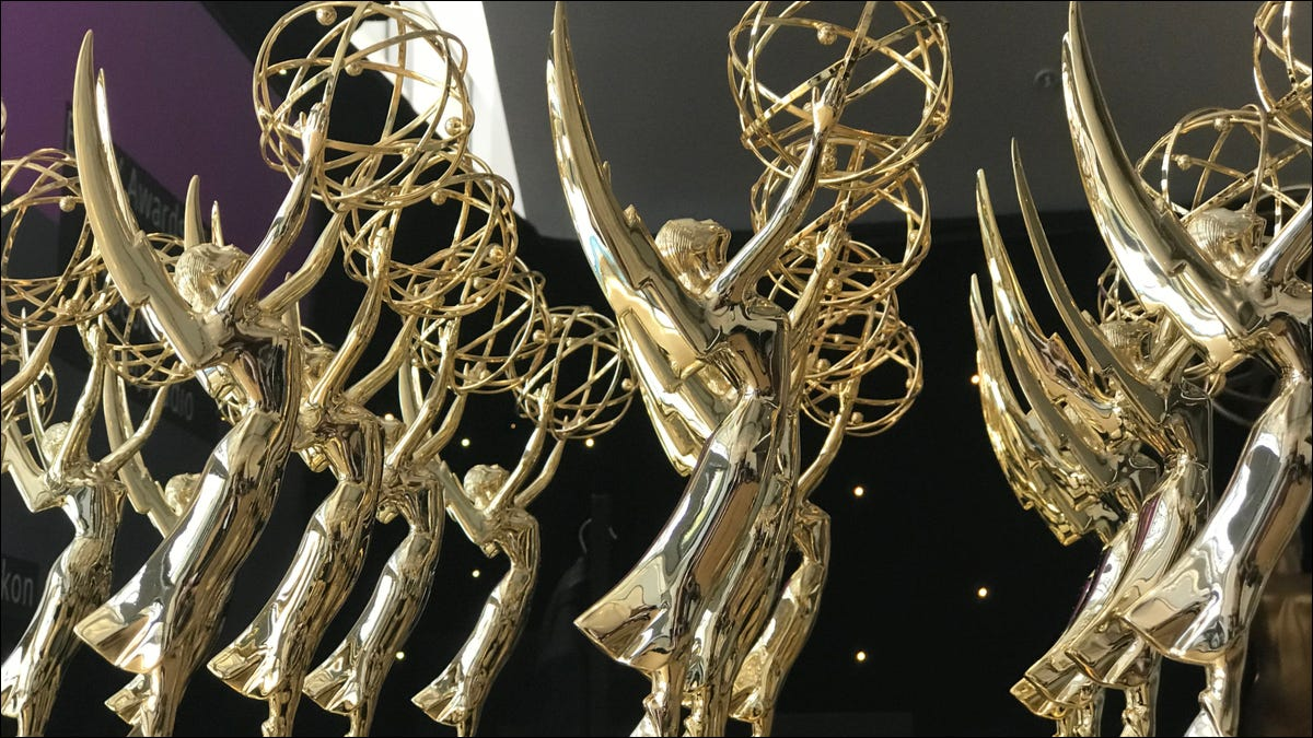 Emmy awards lined up on a table