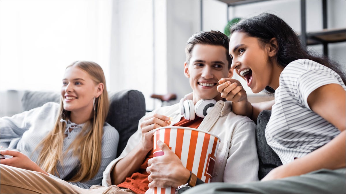 Family sitting on a couple watching Netflix