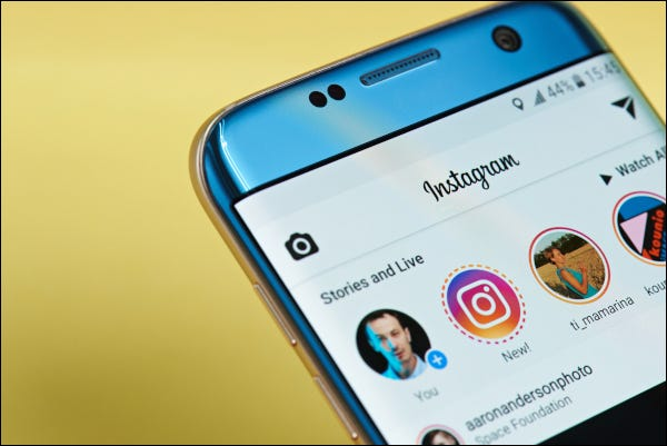 Instagram app open on a smartphone displaying stories and live feeds.