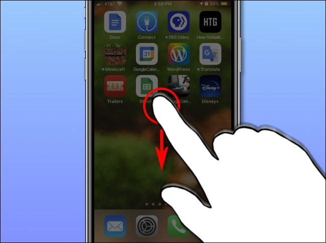 Lauch Spotlight search on iPhone or iPad by swiping your finger down near the center of the screen.
