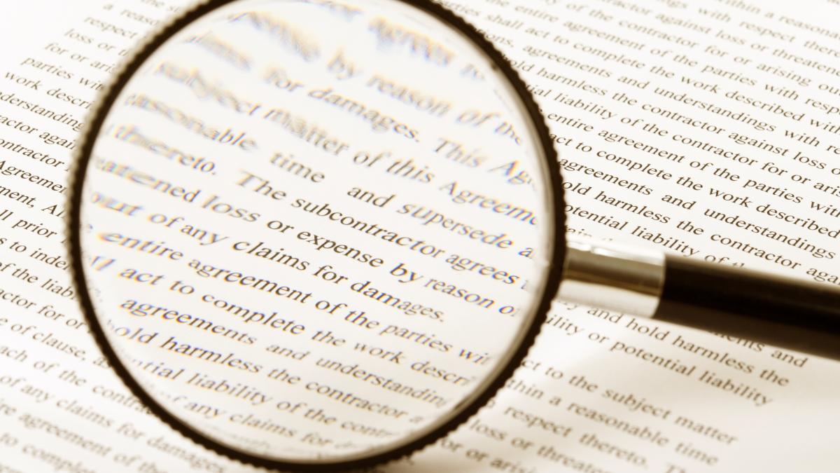 Magnifying glass enlarging book text