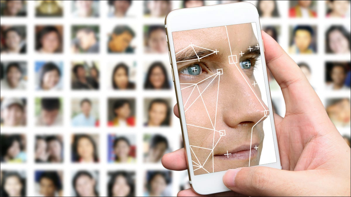 Man's face in a facial recognition app on a smartphone