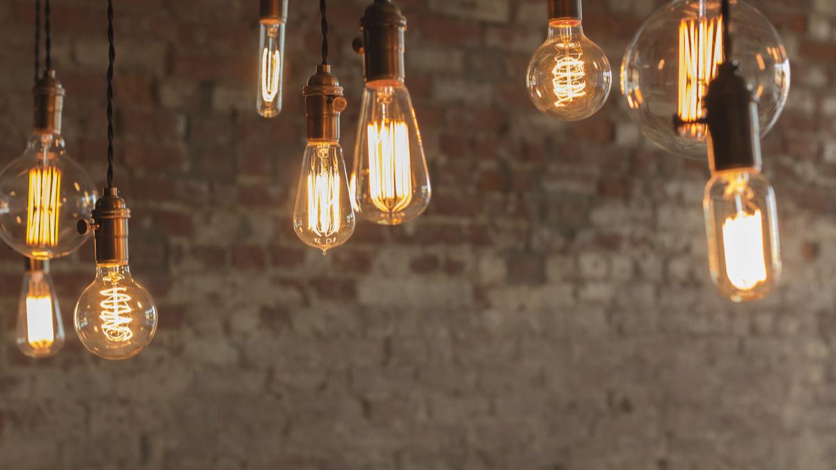Various Edison bulbs against a brick wall.