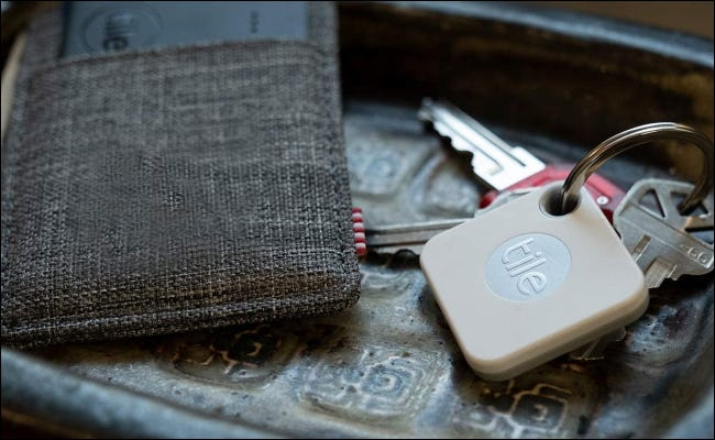 wallet and keys with Tile products in them