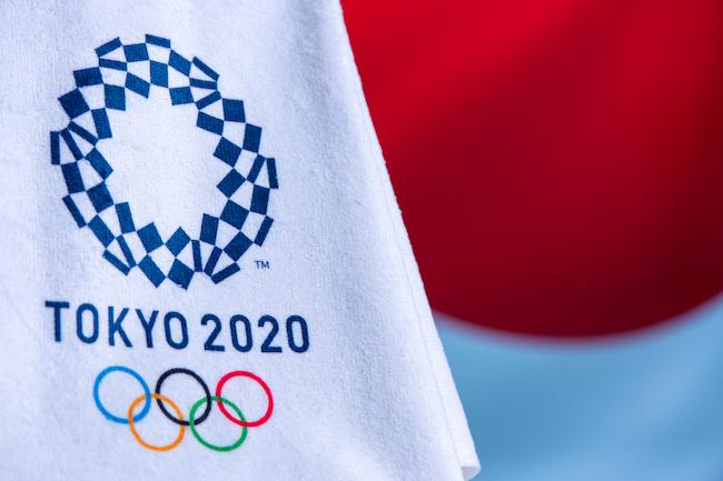 Tokyo 2020 logo on an Olympic flag