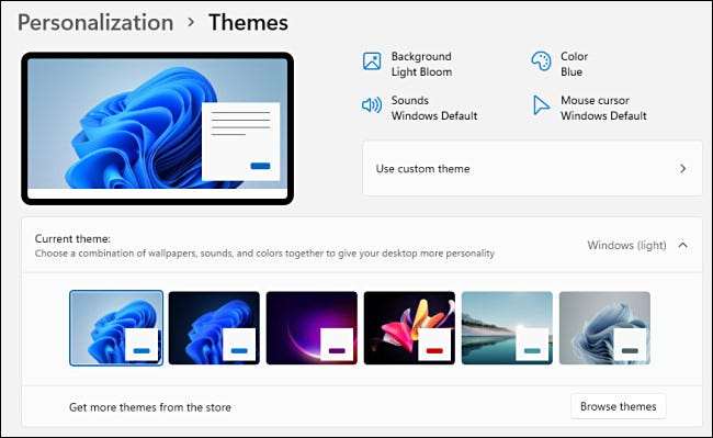 The Windows 11 Personalization > Themes options in Settings.