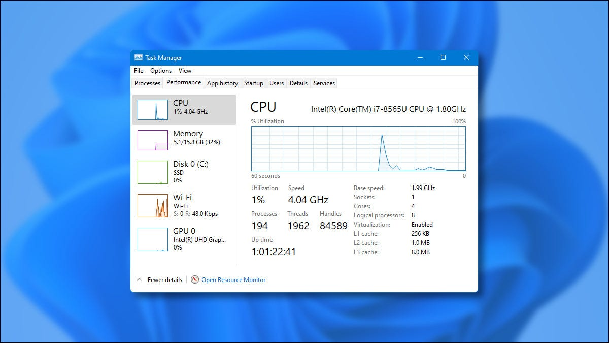 Task Manager in Windows 11 on a blue background