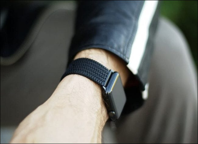 person wearing carterjett band while sitting